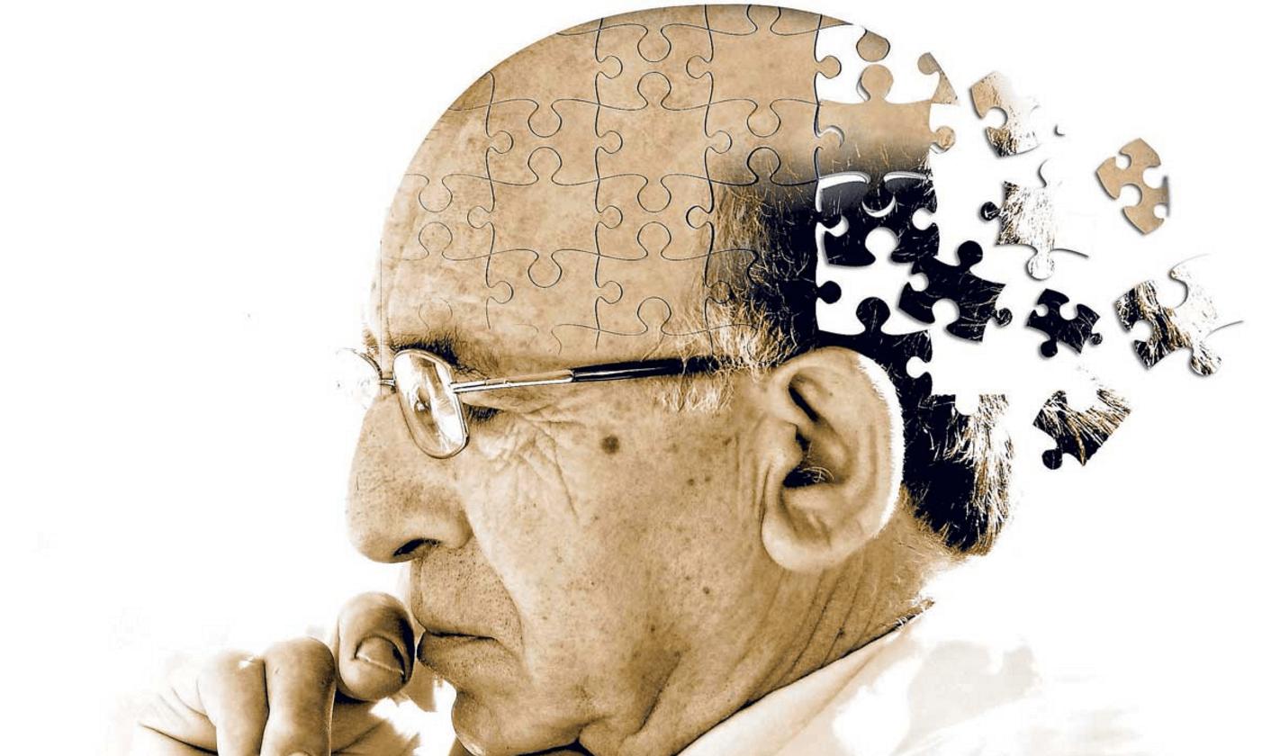 starszy mężczyzna zamyślony, którego upośledza demencja (otępienie)